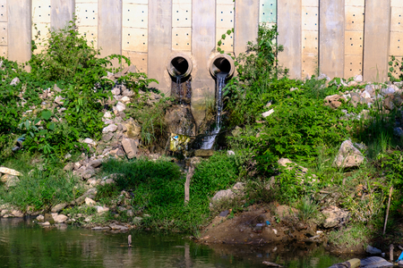 unsafe: Characteristics of Industrial Sewage in River Stock Photo