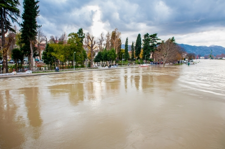 floodplain: Display of swollen river threatening the city and its people. Dangerous level of water.