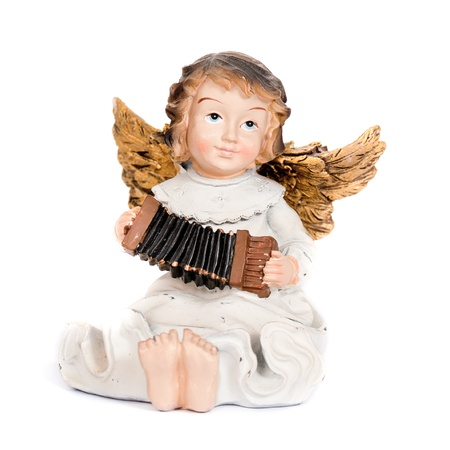 Angel figurine playing accordion photo