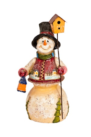 Snowman toy figurine holding a lamp and birdhouse. Stock Photo