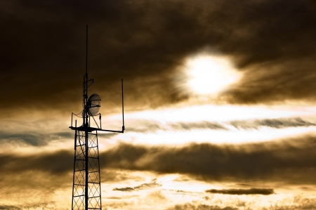Apocalyptic sky with dramatic clouds and radio antenna  A scene reminiscent of the day of judgment  photo