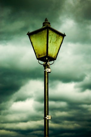 Old lamp on a very cloudy day  Standard-Bild