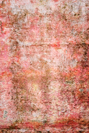 Grungy wall texture in shades of red and orange  photo