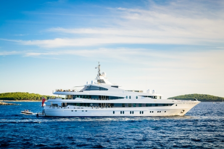 anchored: Luxury yacht anchored in a beautiful bay in the Adriatic Sea under the blue sky Stock Photo