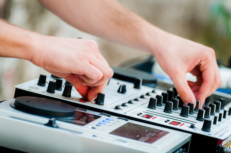 Close-up of sound mixer control panel with dj hands Stock Photo
