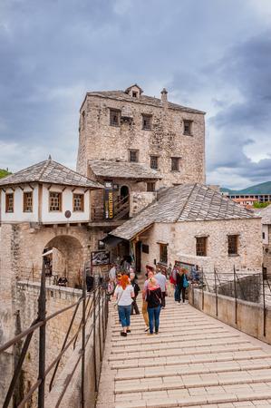mostar: MOSTAR, BOSNIA AND HERZEGOVINA - APRIL 28  Tourists visiting the Old Bridge in Mostar on April 28, 2014