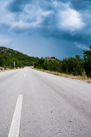 Lonely road in the countryside and cloudy weather photo