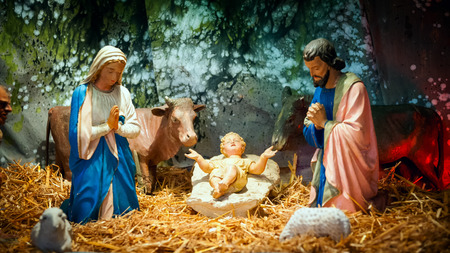 Christmas nativity scene with baby Jesus, Mary   Joseph in barn Stock Photo