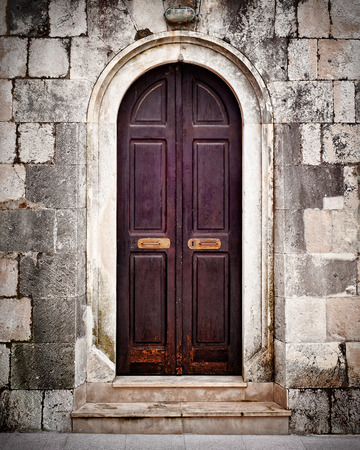 Small old wooden church door photo