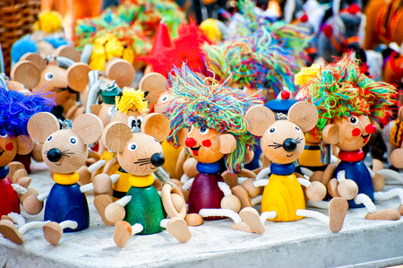 Antique wooden figurines toys at the fair photo