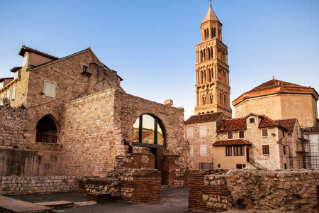 Scene from the old city of Split and the view of old bell tower in sunset Stock Photo