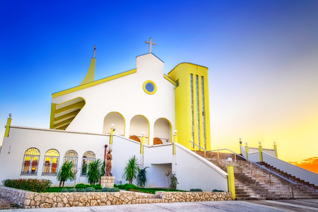 HDR image of modern church in Croatia with blue sky above photo