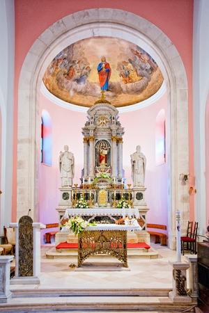 Beautifully decorated the main altar of small Dalmatian church Editorial