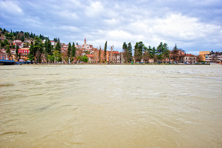 Swollen: Small Mediterranean town along the swollen river and threatening flood Stock Photo