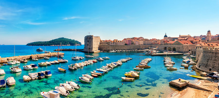 emerald city: Beautiful sunny day over the bay in front of old town of Dubrovnik Editorial