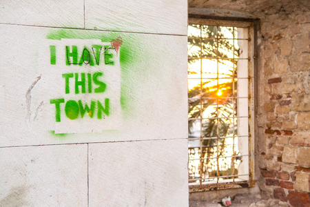 hate: Graffiti on the wall. I hate love this city. Stock Photo