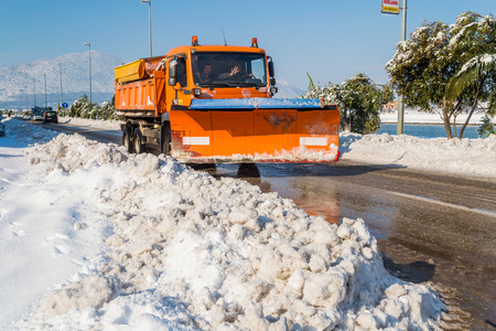 heap snow: METKOVIC, CROATIA - FEBRUARY 5: Excavator cleans the streets of large amounts of snow in Metkovic, Croatia on February 5, 2012. Editorial