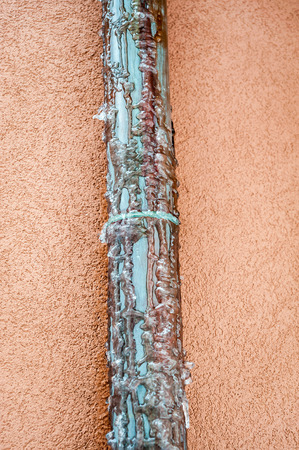 copper pipe: Frozen copper pipe. Water drain from house roof.