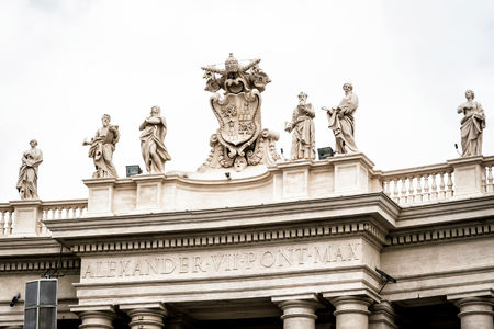 peters: Statues on colonnades that surround St. Peters Square in Rome Stock Photo