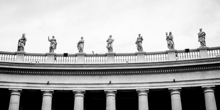 st  peter's square: Statues on colonnades that surround St. Peters Square in Rome Stock Photo