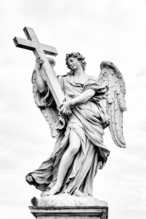 bernini: Angel with the Cross statue on Ponte Sant Angelo bridge in Rome, Italy. Black and white processing.
