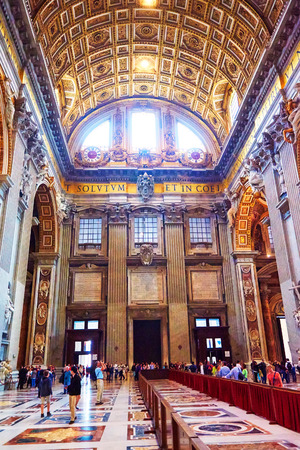 st  peter's basilica pope: VATICAN CITY, VATICAN - OCTOBER 29: The faithful and tourists take a tour of the interior of the basilica of St. Peters in the Vatican, Rome, Italy on October 29, 2014