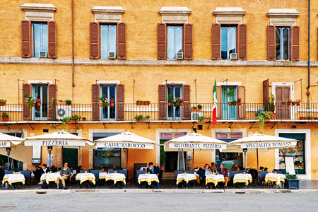 ROME, ITALY - OCTOBER 29: Guests sit on the beautifull restaurant terrace in Piazza Navona in Rome, Italy on October 29, 2014 Editorial