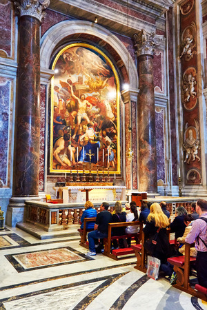 christendom: VATICAN CITY, VATICAN - OCTOBER 29: Faithful pray before the tomb of St. John Paul II at the Basilica of St. Peters in the Vatican, Rome, Italy on October 29, 2014