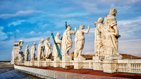apostles: Statues of Jesus Christ and the Apostles on top of the facade of St. Peters basilica in the Vatican Stock Photo