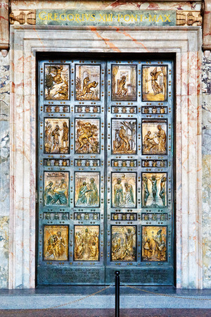 The Holy Door is the northern entrance at St. Peters Basilica in the Vatican. It is cemented shut and only opened for Jubilee Years. Stock Photo