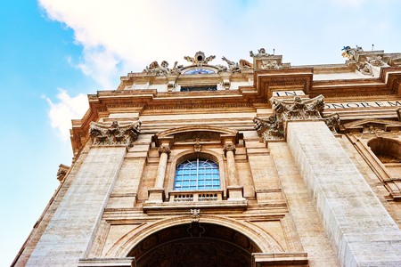 closer: Closer look at the detail of facade of basilica of St. Peters in the Vatican, Rome, Italy
