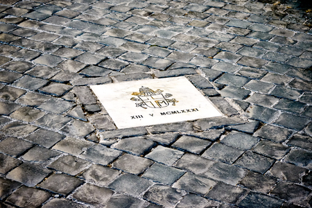 st mark: Exactly marked place on square of St. Peters in the Vatican, Rome, Italy where the assassination of Pope John Paul II happened in 1981 Stock Photo