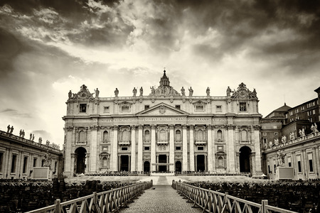 st  peter's basilica pope: Dramatic sunset over facade of the basilica of St. Peters in the Vatican, Rome, Italy. Vintage old sepia film processing.