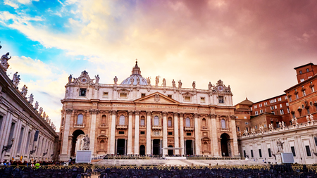 st  peter's basilica pope: Dramatic sunset over facade of the basilica of St. Peters in the Vatican, Rome, Italy
