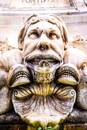 gruesome: Gargoyle near Pantheon in Rome, Italy Stock Photo