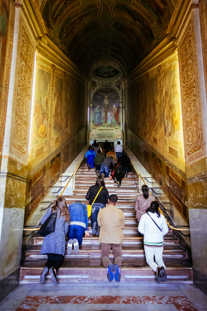 scala: ROME, ITALY - OCTOBER 30: People pray at Holy Stairs, Scala Santa, in Rome, Italy on October 30, 2014.