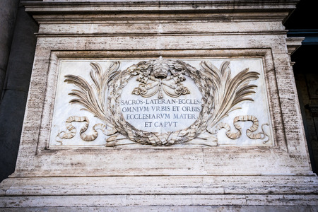 ecclesiastical: ROME, ITALY - OCTOBER 30: Inscription at the entrance to Archbasilica of St. John Lateran says: Most Holy Lateran Church, of all the churches in the City and the world, the mother and head. Rome, Italy on October 30, 2014. Editorial