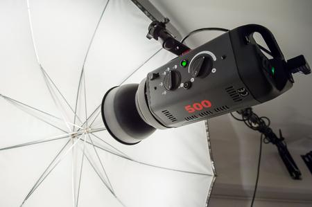 strobe: Photographic studio strobe lighting and reflective umbrella