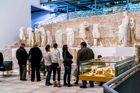 museum visit: VID, CROATIA - JANUARY 27: People visit museum that was built on site of ancient Roman temple in ancient town Narona in Vid, Croatia, on January 27, 2012.