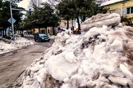 disrupt: METKOVIC, CROATIA - FEBRUARY 10: Large piles of snow disrupt traffic in Metkovic, Croatia on February 10, 2012. Editorial