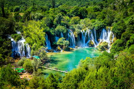 Many tourists visit Kravice waterfalls on Trebizat River near Ljubuski in Bosnia and Herzegovina.