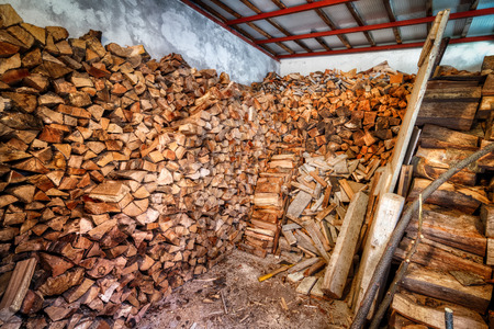 woodshed: Indoor woodshed with nicely arranged chopped firewood Stock Photo