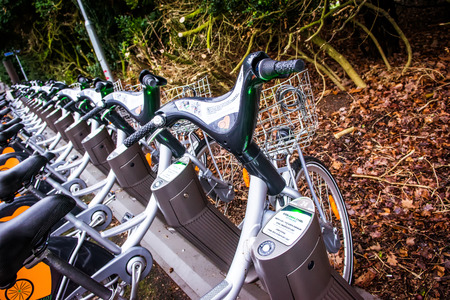 Renting: LUND, SWEDEN - DECEMBER 30, 2014: Parked public bicycles that are part of the renting system in Sweden.