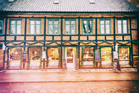 sweden resting: LUND, SWEDEN - DECEMBER 30, 2014: Exterior windows and facade of coffee shop where people rest and socialize during Christmas season in Sweden. Editorial
