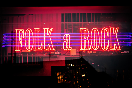 folk music: MALMO, SWEDEN - DECEMBER 31, 2014: Neon lighted shop window of music store with rock & folk music in Malmo in Sweden. Editorial