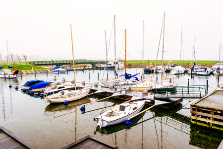 december 31: MALMO, SWEDEN - DECEMBER 31, 2014:Marina with small boats anchored in Malmo in Sweden on a cloudy day.