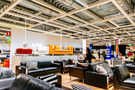 retailer: MALMO, SWEDEN - JANUARY 2, 2015: Interior of large IKEA store with a wide range of products in Malmo, Sweden. Ikea was founded in Sweden in 1943, Ikea is the worlds largest furniture retailer.