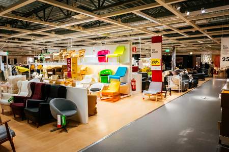 home store: MALMO, SWEDEN - JANUARY 2, 2015: Interior of large IKEA store with a wide range of products in Malmo, Sweden. Ikea was founded in Sweden in 1943, Ikea is the worlds largest furniture retailer.