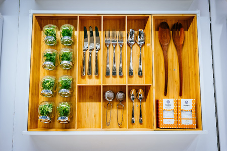 retailer: MALMO, SWEDEN - JANUARY 2, 2015: IKEA dinner set for sale in Malmo, Sweden. Ikea was founded in Sweden in 1943, Ikea is the worlds largest furniture retailer.