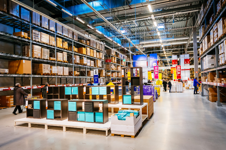 retailer: MALMO, SWEDEN - JANUARY 2, 2015: Interior of large IKEA storehouse with a wide range of products in Malmo, Sweden. Ikea was founded in Sweden in 1943, Ikea is the worlds largest furniture retailer.